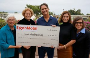 ExxonMobil Foundation presents a cheque to college