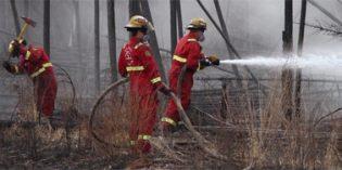 Return of 2,000 Fort McMurray evacuees delayed by ash, debris