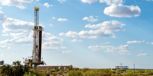 Oil prices dip but notch fourth straight monthly gain