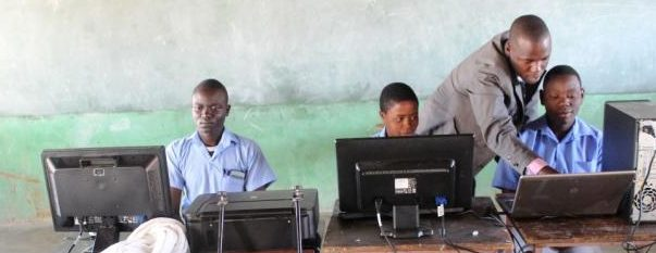 Pupils use solar-powered computers at Gomba High School in Gutu, Zimbabwe. TRF/Jonathan Njerere