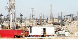 Oil prices edge up on possible OPEC extension, US drawdown