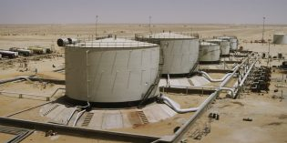 Oil prices dip as investors weigh OPEC cuts against US production increase