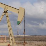 Oil prices recover from 10-month lows, but crude glut still weighs