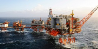 North Sea oil platforms evacuated as drifting barge nears in rough seas