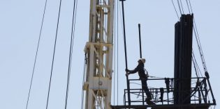 Oil prices up slightly on OPEC deal, but US output concerns traders